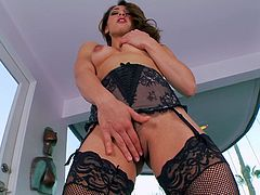 Being alone does not stop Sara from dressing up all sexy and pretending, that she is going to have a good time alone. She puts on her lacy, black lingerie and moves in it, as if teasing her man. She shows off her pert butt and her sexy boobs, then lies down on the floor with her stockinged legs spread out, and puts her fingers inside her tight and yummy pussy.