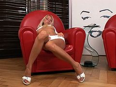 Super sexy blondie takes off white lingerie and strokes her tanned body
