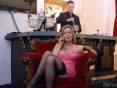 Blonde lady Holly, was feeling very lonely while sitting on the lounge, and the bartender Freddy, takes a chance on her. With a boner, he went in front of her and lustful babe got intimate with him. He got to grope and hug the lady with feeling her wet cunt and tits, while she took the cock out and began to jerk.