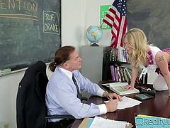 School girls dressed in sexy uniforms look very tempting. Slutty Dakota is one of them. The naughty blonde babe with small tits seduces her teacher. Don't you agree she deserves a big grade? Just watch her moving sensually and climbing on the teacher's desk for a better view of her ass. See her sucking dick!