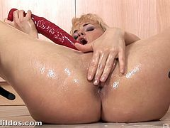 Fancy blonde solo model drills her pink slit with a monster dildo in the kitchen