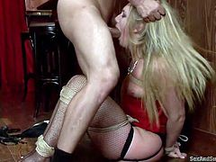 Do you think that submissive sluts are hot? Dare to click and see a long blonde-haired babe sitting on the floor. Her legs and hands are tied up with rope and she has no idea, what the fierce horny guy shall do to her... Watch the bitchy lady mouth fucked and enjoy the sight of her appetizing round ass.