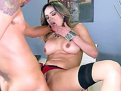 Nadia Styles, a young milf with sexy stockings and a pair of giant tits meets her boss at the office. He spreads her legs wide and stuffs her vagina with cum