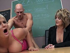 Long haired blonde Julie Cash is a slutty busty student girl. Curvy big titted girl with juicy as gets her hairless meaty pussy banged hardcore style right in front of curious older woman in the classroom.