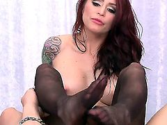 Beautiful inked up redhead Monique Alexander with sexy boobs and nice butt strokes fat hard dick with her sexy warm feet before she takes man meat in her pink vagina in doggy position.