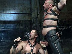 If you have an urge for hardcore gay bdsm activities, feel free to watch! A sexy muscled man finds himself quite helpless, when tied up and bounded strongly by his dominant partner, who seems to have a big sexual appetite. Both men wear kinky leather pants, which suit them perfectly. Can Hugh bare the pain?