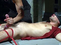 Two horny gays are having a minion tied with ropes and blindfolded, who is enjoying every moment of the kinky threesome gay fun. The guys sucking his bound cock and making it explode with excitement. Teasing with the dick and sucking the nipples, seem to be not enough, so they give him footjob, to make him crazier.