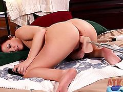 Brunette Brandi Belle with tiny tits and clean pussy satisfies herself