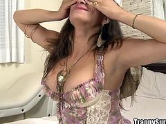 She is looking super sexy on the bed in her hot lingerie. The nasty tranny pulls out her rock hard cock and strokes it for a while. She brings herself to the edge and now, she is ready to suck on her man's cock. They kiss and he gives her a handjob.