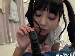 This Japanese chick may look young, but she knows more than one could imagine. Watch this young whore play fuck games with a sex doll. She goes up to the doll and takes the dildo in her hand, feels it, as if it were real. Then she makes sure that she practices well and takes it in her mouth, to get the feel of the real thing.