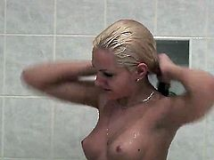 Cute blonde girl with perky tits and clean pussy shows every inch of her lovely nude body as she takes a shower. She is all wet and dangerously sexy! Dick-hardening video!