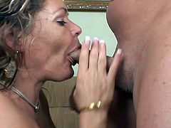 Sizzling cougar with nice big tits enjoying a hardcore missionary style fuck