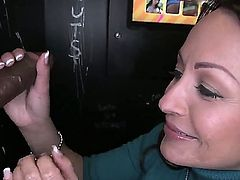 Charming long haired brunette Vanessa Luna wraps her lips around fat black cock in interracial gloryhole action. Watch clothed lady from Venezuela suck cocks with wild passion.