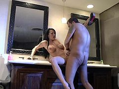 Good looking brunette Alektra Blue with amazing biog melons opens her long legs and gets her wet pussy penetrated in the bathroom. She gets shagged with her stiletto shoes on.