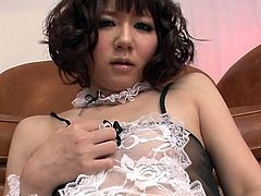 Curly Asian maid Yurika Miyachi shows off her ass and shaved pussy