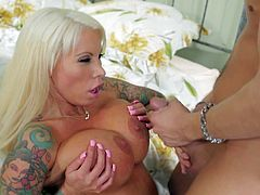 His dads new blonde wife Lolly Ink is a bombshell with fake huge boobs and beautiful bald pussy. This fine looking busty woman in black stockings takes Kevin Moore blood filled cock in her wet milf pussy eagerly.