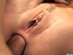 Very slutty brunette skank has a problem with too many dicks. Her boobs dangle as she is fucked in the ass and she is sucking on the other one in front of her.