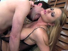 Fishnet-clad blonde whore with nice big tits enjoying a hardcore missionary style fuck