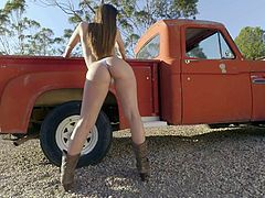 Playful country girl Brooklyn Chase with killer curves strips down to her tiny panties outdoors in the sun. She shows off her huge boobs and rubs her snatch beside a pick up truck.