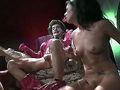 Joker is in town and there is no Batman to stop him from having his was with two gorgeous women. He makes a threesome with them. It gets very steamy.