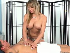Buxom fair haired sweetie teases horny guy with her juicy boobs in massage parlor