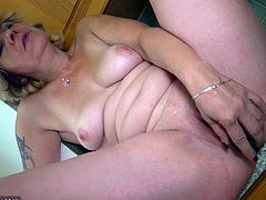 Dirty-minded bond haired mature wanker Kristina fucks with toy in kitchen