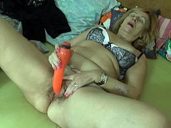 Old light haired nympho with saggy ugly tits uses dildo to fuck cunt