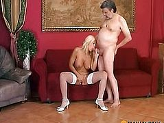 Blonde in stockings swallows cock