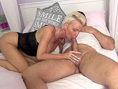 While Jill is resting in bed, her horny partner tries to awake her, by sucking sensually her nice nipples. Click to watch the slutty short blonde-haired mature bitch, waking up from her lusty dreams and getting to business right away... She seems so eager to suck cock!