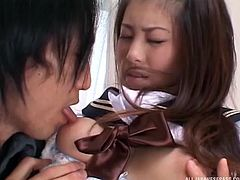 Naughty Japanese college girl in uniform enjoys riding a big cock hardcore