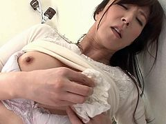 If you like sensual milfs, don't hesitate to take a look at this horny Japanese bitch! The lusty lady fingers her hot pussy in bed, showing off her lovely ass and natural tits to the camera. Click to watch slutty Reiko masturbating!