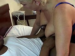 Black dude has wild oral sex with busty mature blonde in bed
