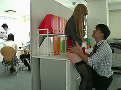 Tia couldn't wait to get nasty in the office. The dirty girl went behind the file cabinets and opened up her legs for her man. Watch the bad girl get fingered deeply, before grabbing his cock and sucking him off.