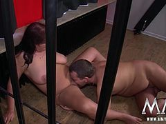 Two couples party hard in the private cage of the swingers club.