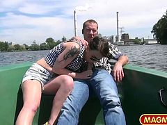 Fabienne drops her panties and spreads her legs while wanking the two horny guys that want to fuck her brains out on a freaking rowing boat.