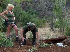 Well stacked leggy blonde Stormy Daniels is dangerously sexy in her skin tight military uniform. Lovely woman in short skirt and tank top turns man on in outdoor scene.