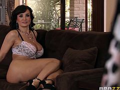 Slutty Lisa Ann, finds an exciting way to get rid of routine. The brunette milf with gorgeous tits seems to have forgotten, she's married and is eager to spend sexy moments in the company of a black cock, while her husband is not around. See her ass rimmed passionately, before she gets banged from behind!