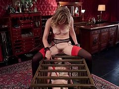 Between the bars of her cage, a slutty brunette is eating Mona's pussy, just until she has to taste a horny guy's cock. See the sensual blonde-haired bitch fucked hard from behind, while leaning on the kinky cage.
