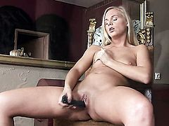 Barbie White is horny as hell and fucks her bush with her toy on cam
