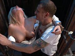 Talking to prisoners can get you into trouble, but naughty Kate takes that risk... The horny persuasive man takes advantage of her naivety, to put her hands in shackles and make this slutty blonde suck his dick, while on knees. Pinching nipples makes her really aroused!