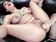 A busty brunette got her lovely body bonded with ropes. The sexy mistress, Chanel, is wearing a kinky strap on, which she intends to stuff in her companion's peachy pussy and yummy ass. See the scenes!