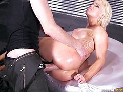 Nikki is a seductive blonde babe, with gorgeous boobs and a crazy ass. Her nude, oiled body looks very appetizing. See this slut fucked from behind, sideways and spreading legs widely!