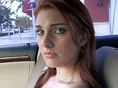Cute red-haired chick Rainia Belle makes her big beautiful eyes on camera in a car.This playful young girl hides her juicy boobs under her tight fit top. Nice chick!