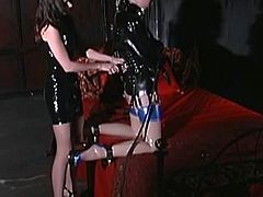 Slutty redhair lesbo in bondage gets her pussy wedged and sucked