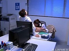 They stay late at the downtown Shinjuku office for some really sexy fun, while all the other employees are at home. She blows his cock, while he sits at his desk, and he kisses her intently. She even sucks on his balls so seductively.