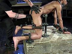 This ebony slutty lady gets the prisoner of the kinky bondage device. No one can hear her whispers and she is completely helpless. The merciless executor is gonna bring this bitch to brutal orgasms, as he's also using sex toys, such a vibrator. See the inciting scenes!