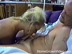She keeps his cock on a leash and sucks his balls
