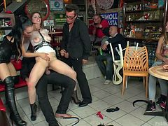 There's nothing like taking some woman out in public and making her submit to all sorts of things, both sexual and degrading. Liza makes Lucia say, she wants to ride a dick and then does ride, soon taking it in her ass. They coerce her take another dick in her pussy right in the middle of this shop.