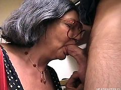 Big Bertha is eager to reveal her hidden skills and when it comes to acting dirty, this versed granny wearing glasses becomes a real player, who enjoys to taste cock. Click to watch the slutty woman with gray hair and saggy tits sucking dick.