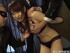 This cute Japanese slut is locked in prison with a group of horny men. The masked bandits strip her naked and make her suck on their massive cocks. Look at how the skank chokes on their big penises in her cell. She has to take it, because they are the ones in charge.